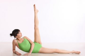 girl doing stretches on floor